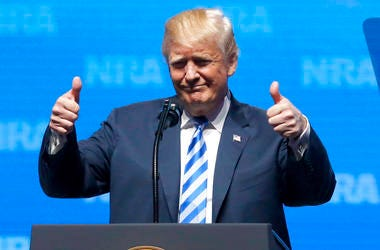 President Donald Trump gestures from the podium as as speaks at the National Rifle Association-Institute for Legislative Action Leadership Forum.