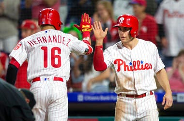 Philadelphia Phillies' Cesar Hernandez (16) high fives Scott Kingery after hitting a two run home run in the fourth inning.