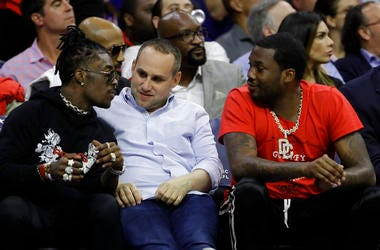 Philadelphia 76ers' co-owner Michael Rubin, center, talks with rappers Lil Uzi Vert, left, and Meek Mill during the first half of Game 4 of an NBA basketball second-round playoff series against the Boston Celtics in Philadelphia.