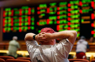 A man watches a baseball game in the sports book at the South Point hotel-casino in Las Vegas.