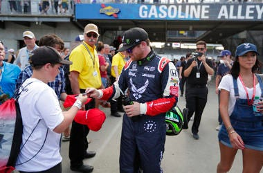 Conor Daly signs an autograph for a fan after he qualified for the IndyCar Indianapolis 500 auto race at Indianapolis Motor Speedway in Indianapolis.