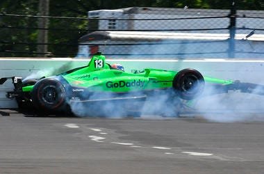 Danica Patrick hits the wall in the second turn during the running of the Indianapolis 500 auto race at Indianapolis Motor Speedway.