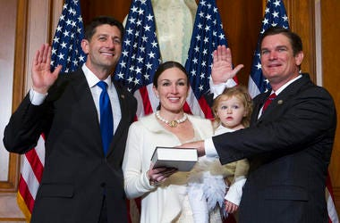 House Speaker Paul Ryan of Wis. administers the House oath of office to Rep. Austin Scott, R-Ga., during a mock swearing in ceremony on Capitol Hill in Washington.