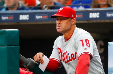 In this photo, Philadelphia Phillies manager Gabe Kapler watches the team play the Detroit Tigers in the first inning of a baseball game in Detroit.