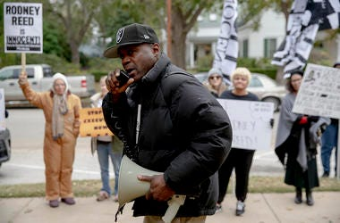 odrick Reed leads a chant during a protest against the execution of Rodney Reed on Wednesday, Nov. 13, 2019, in Bastrop, Texas.