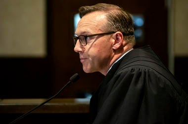 In this Aug. 26, 2019 file photo, Judge Thad Balkman reads a summary of his decision in the opioid trial at the Cleveland County Courthouse in Norman, Okla.