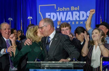 Louisiana Gov. John Bel Edwards celebrates with his wife Donna Edwards as he arrives to address supporters at his election night watch party in Baton Rouge, La., Saturday.