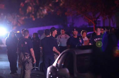 Police and emergency personnel are on the scene of a shooting at a backyard party, Sunday, Nov. 17, 2019, in southeast Fresno, Calif.
