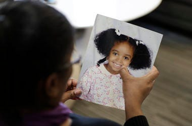 Donnesha Cooper touches a photo of her daughter, Alianna DeFreeze, in Cleveland on Oct. 29, 2019.