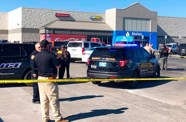 Law enforcement work the scene where two men and a woman were fatally shot Monday, Nov. 18, 2019, outside a Walmart store in Duncan, Okla.