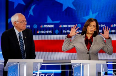 Democratic presidential candidate Sen. Kamala Harris, D-Calif., speaks as Democratic presidential candidate Sen. Bernie Sanders, I-Vt., listens during a Democratic presidential primary debate, Wednesday, Nov. 20, 2019, in Atlanta.