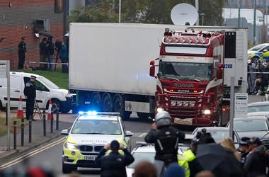 Police escort the truck, that was found to contain a large number of dead bodies, as they move it from an industrial estate in Thurrock, south England, on Wednesday, Oct. 23, 2019.
