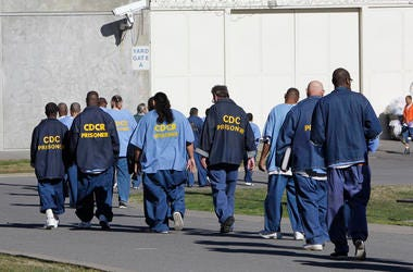 Inmates walk through the exercise yard at California State Prison Sacramento, near Folsom, Calif., on Feb. 26, 2013.