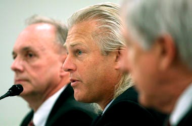 Christopher Lischewski, center, the former CEO of Bumble Bee Foods, has been convicted for his part in a canned tuna price-fixing conspiracy involving the industry's top three companies.