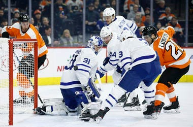 Philadelphia Flyers' Scott Laughton (21) scores a goal past Toronto Maple Leafs' Frederik Andersen (31) as Justin Holl (3) and Morgan Rielly (44) defend during the second period of an NHL hockey game, Tuesday, Dec. 3, 2019, in Philadelphia.