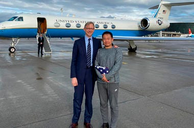 U.S. special representative for Iran, Brian Hook stands with Xiyue Wang in Zurich, Switzerland on Saturday, Dec. 7, 2019.