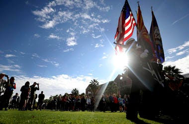 The University of Arizona Navy ROTC color guard present the colors during ceremonies on the school's mall commemorating the USS Arizona and Pearl Harbor Day, Tucson, Ariz., Saturday, Dec. 7, 2019.