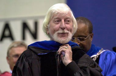 """Caroll Spinney, center, best known for his TV character """"Big Bird"""" from Sesame Street, receives an honorary doctor of Humane Letters degree from Eastern Connecticut State University President David G. Carter, right."""