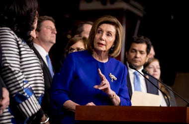 House Speaker Nancy Pelosi of Calif., accompanied by House Congress members speaks at a news conference to discuss the United States Mexico Canada Agreement (USMCA) trade agreement, Tuesday, Dec. 10, 2019, on Capitol Hill in Washington.