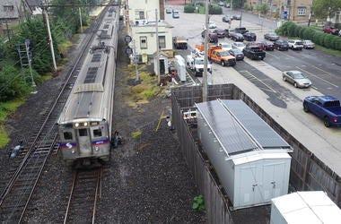 SEPTA regional rail with solar-powered signal