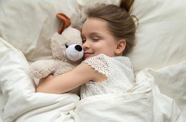 A young girl sleeping.