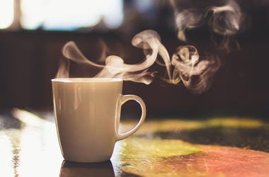 A cup of a hot drink.