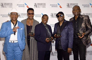 """Dennis Thomas, James """"JT"""" Taylor, Robert """"Kool"""" Bell, Ronald Bell, and George Brown of Kool & The Gang pose with their awards."""