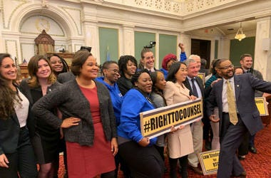 Councilmember Helen Gym poses with advocates in Philadelphia City Council.
