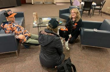 17-year-old Jack Stockmal (left) and his mother Carrie (middle), with neuropsychologist Jennifer West-Gavin and service companion dog Lullaby (right).