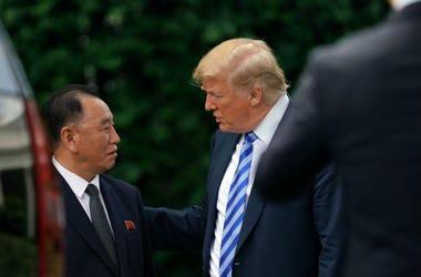 President Donald Trump talks with Kim Yong Chol