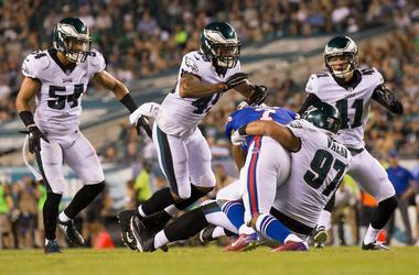 Buffalo Bills running back Taiwan Jones (7) is tackled by Philadelphia Eagles defensive tackle Destiny Vaeao (97) and safety Tre Sullivan (49) during the second half at Lincoln Financial Field.