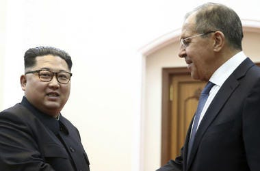 Korean leader Kim Jong Un, left, and Russia's Foreign Minister Sergei Lavrov