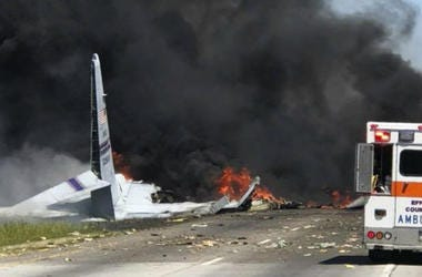 Flames and smoke rise from an Air National Guard C-130 cargo plane after it crashed near Savannah, Ga., Wednesday, May 2, 2018.
