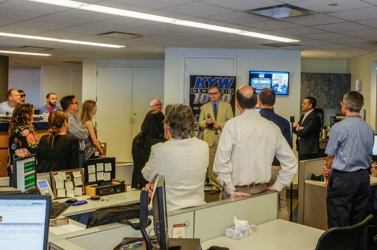 Retired KYW Newsradio reporter Tony Hanson receives a Hall of Fame award in the KYW Newsradio newsroom.