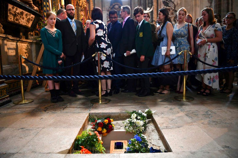 The ashes of Professor Stephen Hawking are laid to rest during his memorial service at Westminster Abbey.