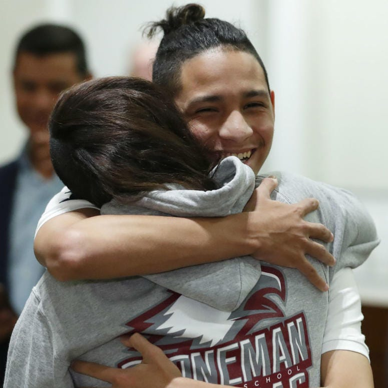 Anthony Borges, rear, who was shot during the Parkland, Fla., school shooting, hugs Marianne Sheehan after a news conference with Florida governor Ron DeSantis, Wednesday, Feb. 13, 2019, in Fort Lauderdale, Fla.