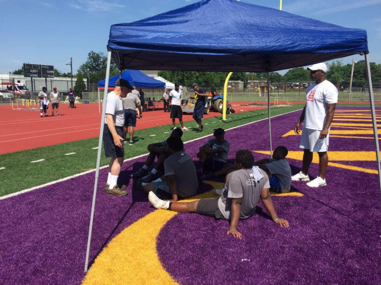The weather might be challenging to play sports outdoors, but a group of inner-city kids endured the heat for the Woodland Community Development Corporation's fourth annual youth athletic forum.