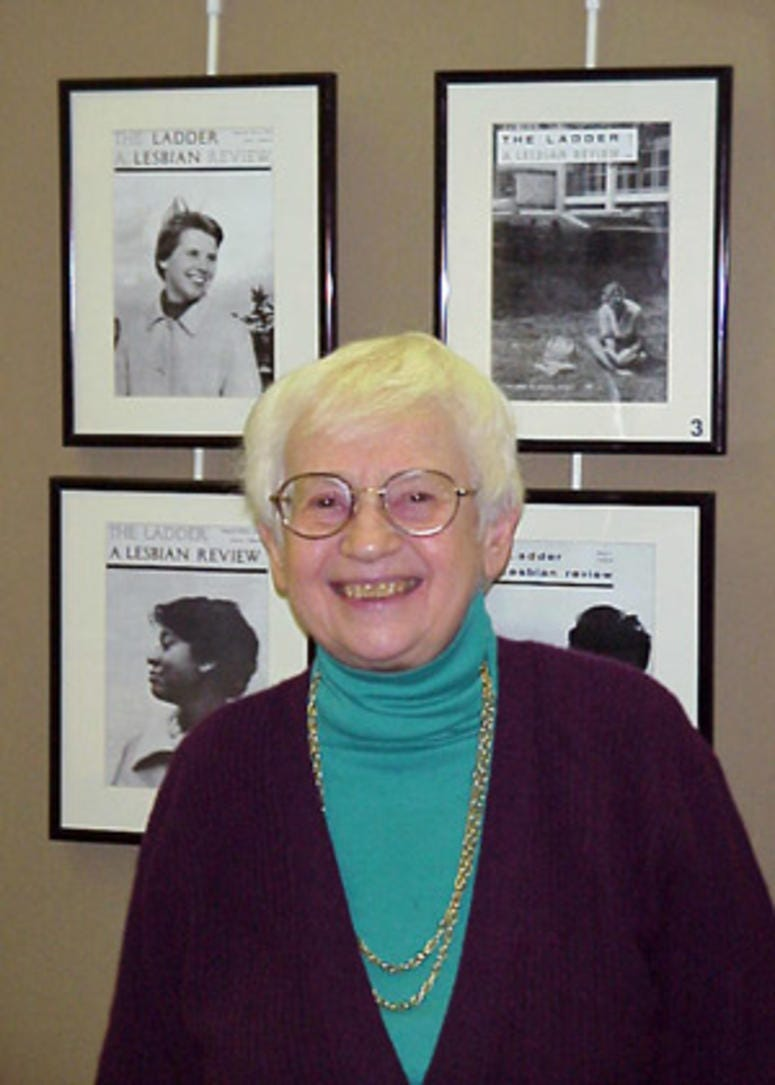 Kay Tobin-Lahusen is shown in front of a collection of her images from the cover of The Ladder.