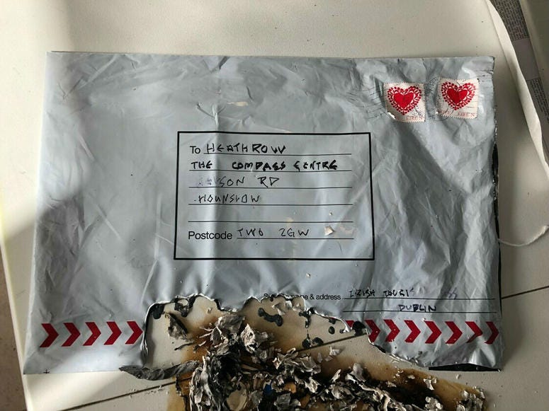 In this photo dated Tuesday March 5, 2019, issued by Britain's Metropolitan Police showing a suspect package after it ignited, sent to Heathrow airport.