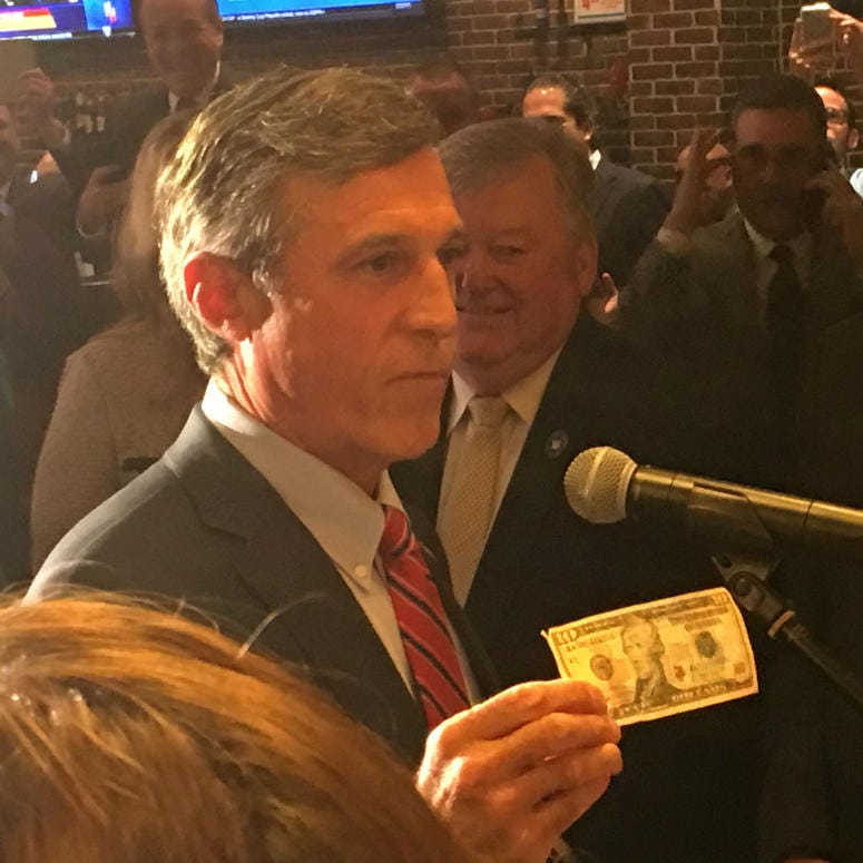 Delaware Gov. John Carney places a $10 bet on the Phillies.
