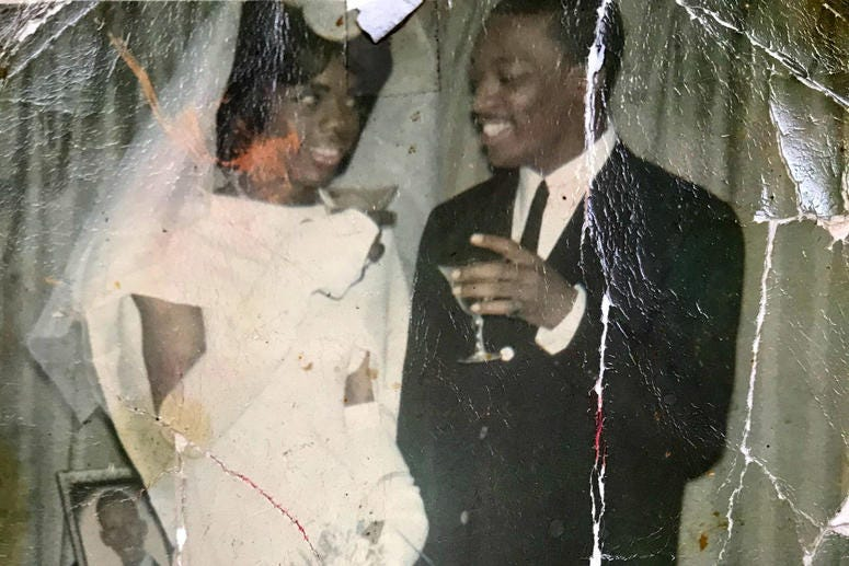 Tyrone Smith is shown wearing a wedding dress on the day he spoke vows to the love of his life.