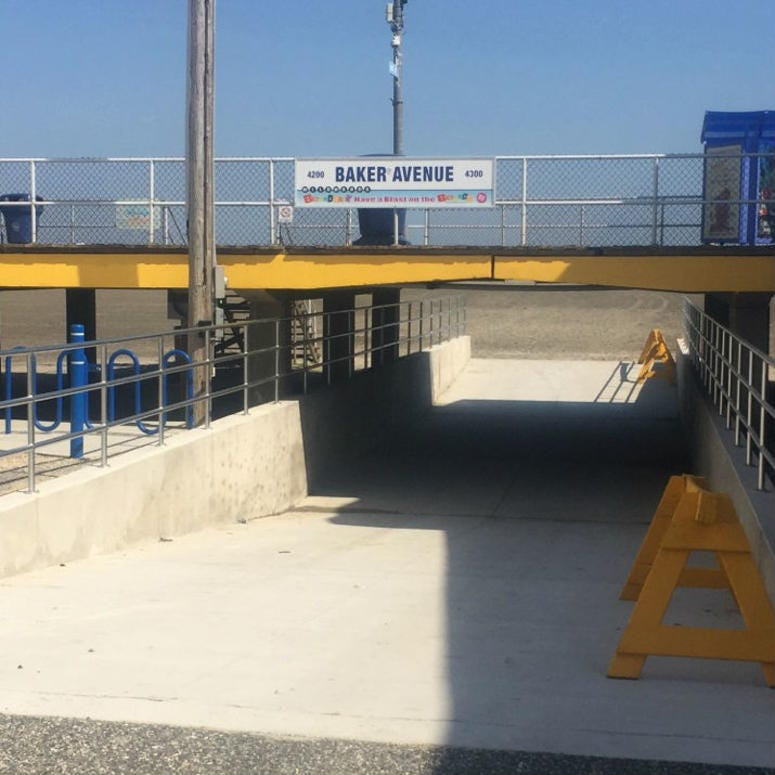 For $10, beachgoers can drive their four-wheel-drive vehicles through a one-way tunnel to park on Wildwood's beach.