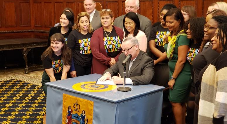 Mayor Jim Kenney signs domestic workers bill of rights.
