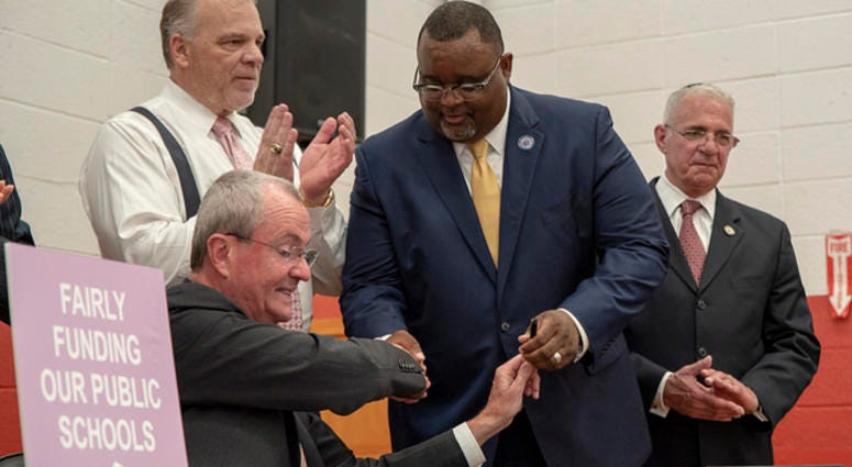 Gov. Phil Murphy signs legislation on fairly and fully funding New Jersey public schools on Tuesday, July 24, 2018.