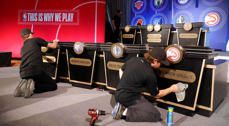 Stage hands prepare the set for the NBA basketball draft lottery.