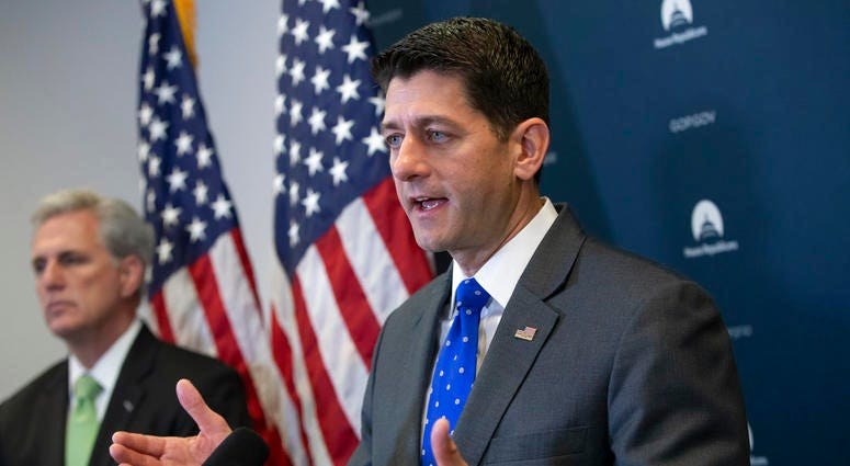Speaker of the House Paul Ryan, R-Wis., joined by Majority Leader Kevin McCarthy, R-Calif., left, talks to reporters following a GOP strategy session at the Capitol in Washington, Tuesday, June 26, 2018.