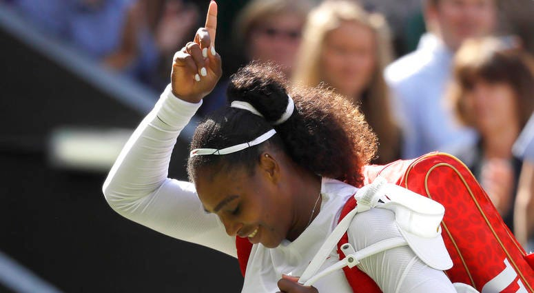 Serena Williams of the United States celebrates winning her women's singles quarterfinals match against Italy's Camila Giorgi, at the Wimbledon Tennis Championships, in London, Tuesday July 10, 2018.