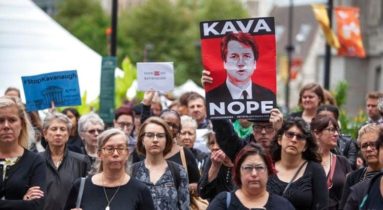 A crowd gathers at Dilworth Plaza by the city hall for a walkout in solidarity with Christine Blasey Ford, who accused Brett Kavanaugh of sexual assault, in Philadelphia on Monday, Sept. 24, 2018.