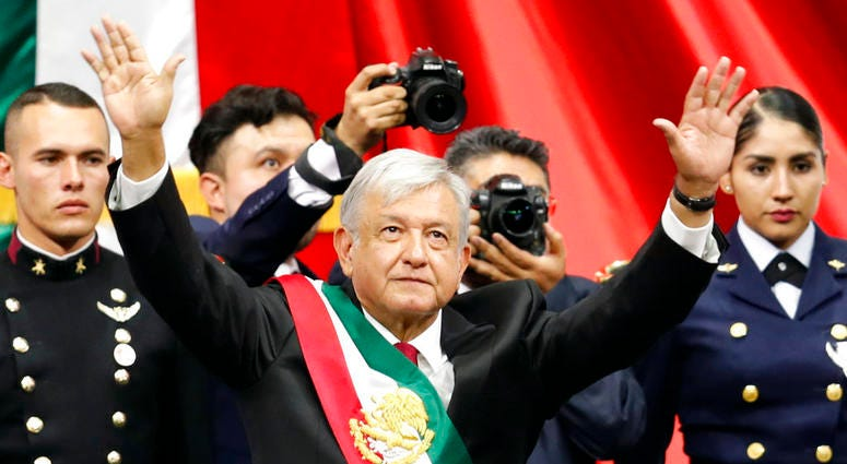 Mexico's new President Andres Manuel Lopez Obrador greets the crowd at the end of his inaugural ceremony at the National Congress in Mexico City, Saturday, Dec. 1, 2018.