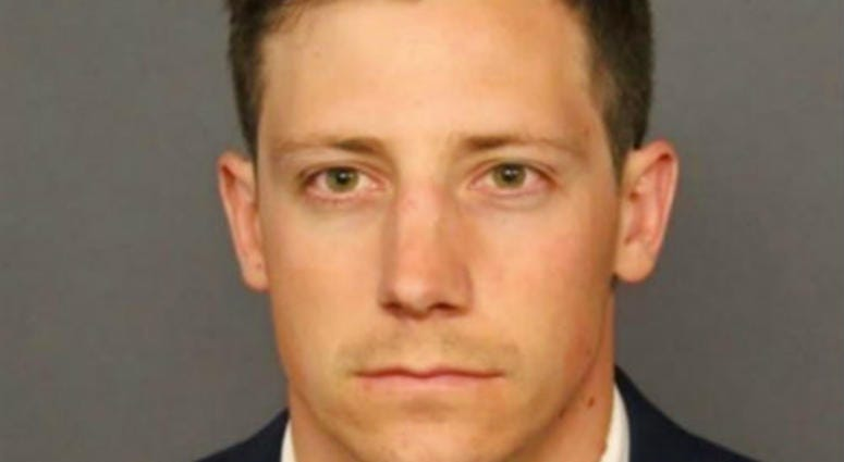 FILE - This undated file photo provided by the Denver Police Department shows Chase Bishop, an off-duty FBI agent agent who accidentally shot a man in the leg after doing a backflip while dancing at a Denver bar.